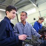 Mechanics training class with teacher and students
